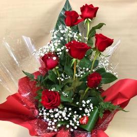 Mazzo di fiori lungo 7 rose rosse con riserva d'acqua
